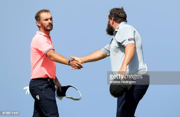 Joost Luiten of Netherlands and Andrew Johnston of England shake hands on the par four 9th green during the second round of the NBO Oman Open at Al...