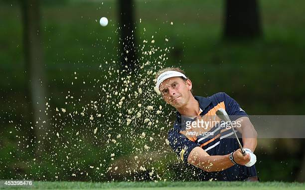 Joost Luiten of Netherlands hits his second shot from a bunker on the eighth hole during the third round of the 96th PGA Championship at Valhalla...