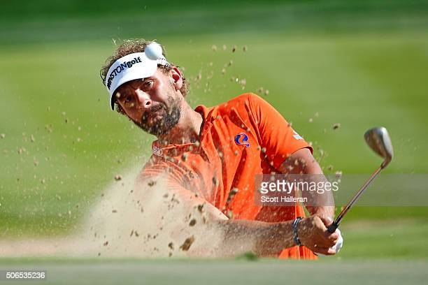 Joost Luiten of Netherlands plays from a bunker during round four of the Abu Dhabi HSBC Golf Championship at the Abu Dhabi Golf Club on January 24...