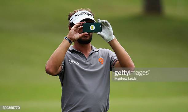 Joost Luiten of Netherlands takes a picture on his mobile phone during the proam event prior to the Open de Espana at Real Club Valderrama on April...