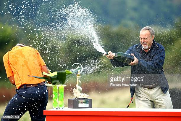 Joost Luiten of the Netherlands and Sir Terry Matthews spray champage following Luiten's victory on day four of the ISPS Handa Wales Open at Celtic...