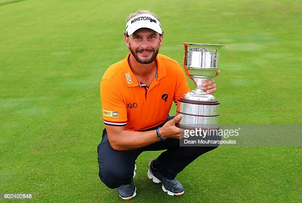 Joost Luiten of the Netherlands celebrates victory with the trophy after the final round on day four of the KLM Open at The Dutch on September 11...