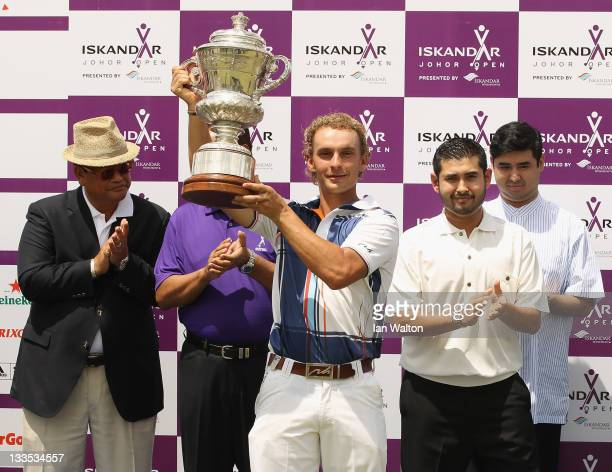 Joost Luiten of the Netherlands celebrates with the trophy after winning the 3rd and final round of the Iskandar Johor Open at the Horizon Hills Golf...