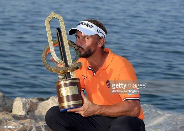 Joost Luiten of the Netherlands celebrates with the winners trophy after the final round of the NBO Oman Open at Al Mouj Golf on February 18 2018 in...
