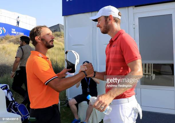 Joost Luiten of the Netherlands is congratulated by Chris Wood of England after the final round of the NBO Oman Open at Al Mouj Golf on February 18...