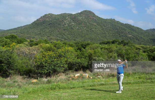 Joost Luiten of The Netherlands plays his approach shot on the 11th hole during Day One of the South African Open at Gary Player CC on December 03,...