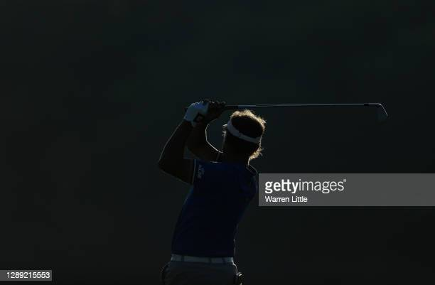 Joost Luiten of The Netherlands plays his approach shot the 18th hole during Day One of the South African Open at Gary Player CC on December 03, 2020...