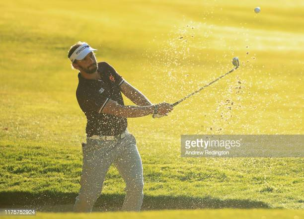 Joost Luiten of the Netherlands plays his third shot from the bunker on the 15th hole during Day One of the BMW PGA Championship at Wentworth Golf...