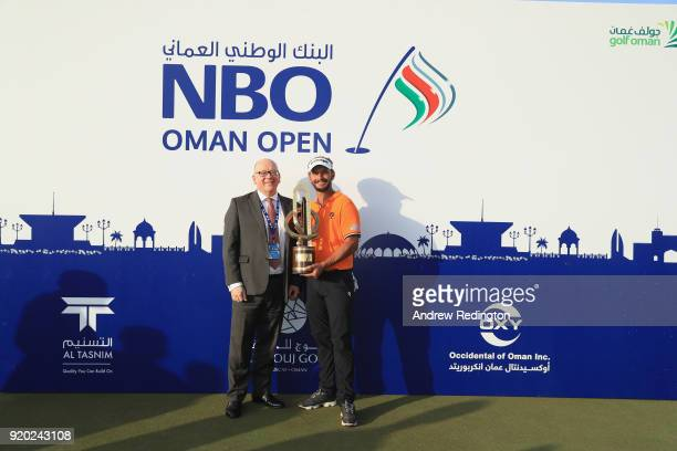 Joost Luiten of The Netherlands poses with the trophy after winning the NBO Oman Open at Al Mouj Golf on February 18 2018 in Muscat Oman