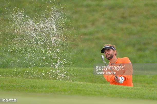 Joost Luiten of The Netherlands swings out of the bunker during day four of the HNA Open de France at Le Golf National on July 2 2017 in Paris France