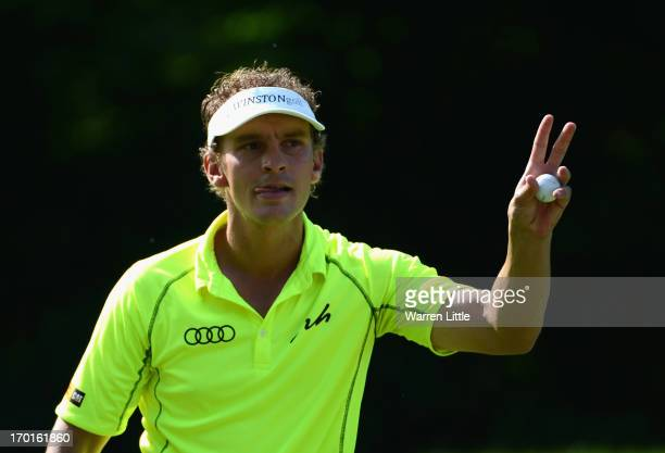 Joost Luiten olf the Netherlands acknowledges the crowd on the 18th green during the third round of the Lyoness Open powered by Greenfinity at...