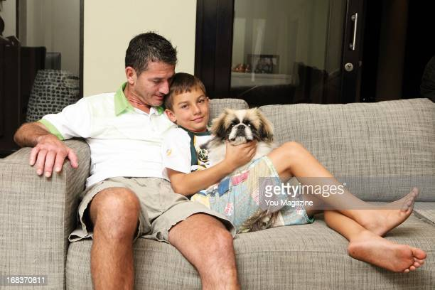 Joost van der Westhuizen poses with his son Jordan and his dog Buddy at his new home on April 22 2013 in Dainfern Johannesburg South Africa His...