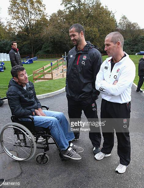 Joost van der Westhuizen the former South African Sprinbok who is suffering with Motor Neurone Disease talks with England head coach Stuart Lancaster...