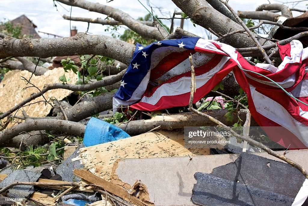 Joplin Missouri deadly F5 Tornado debris piled and American Flag : Stock Photo