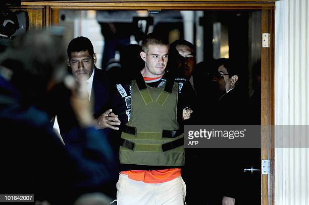 Joran Andreas Petrus van der Sloot is escorted by Peruvian police as he arrives to the DIRINCRI office in Lima on June 5 2010 Peruvian police had...
