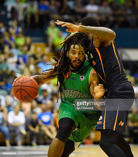 Jordair Jett of the Crocodiles drives to the basket past Torrey Craig of the Taipans during the round nine NBL match between the Townsville...