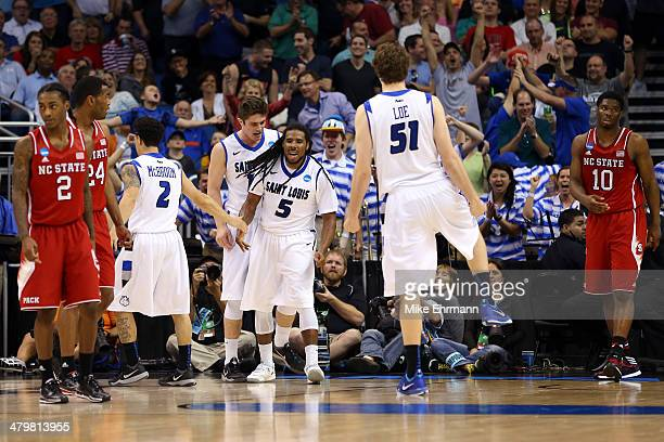 Jordair Jett of the Saint Louis Billikens celebrates a basket in the second half to tie the game against the North Carolina State Wolfpack during the...