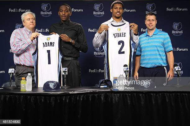 Jordan Adams #1 and Jarnell Stokes #2 of the Memphis Grizzlies are introduced by Chris Wallace and Dave Joerger during an introductory press...