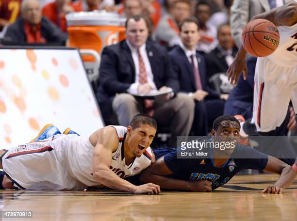 Jordan Adams of the UCLA Bruins steals the ball from Nick Johnson of the Arizona Wildcats late in the championship game of the Pac-12 Basketball...