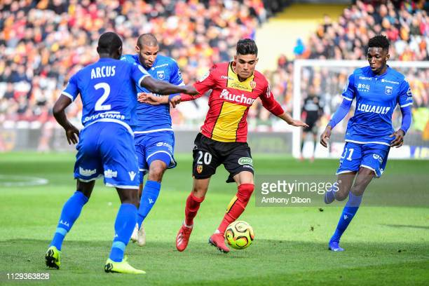 Jordan Adeoti of Auxerre Achraf Bencharki of Lens and Lamine Fomba of Auxerre during the Ligue 2 match between RC Lens and AJ Auxerre at Stade...
