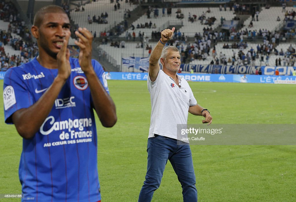 Jordan Adeoti of SM Caen (left) and coach of SM Caen Patrice Garande thank their supporters following the French Ligue 1 match between Olympique de Marseille (OM) and SM Caen at Stade Velodrome on August 8, 2015 in Marseille, France.
