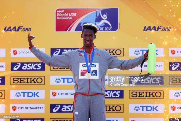 Jordan ADiaz of Cuba celebrates celebrates with his medal during the medal ceremony for the men's triple jump on day five of The IAAF World U20...