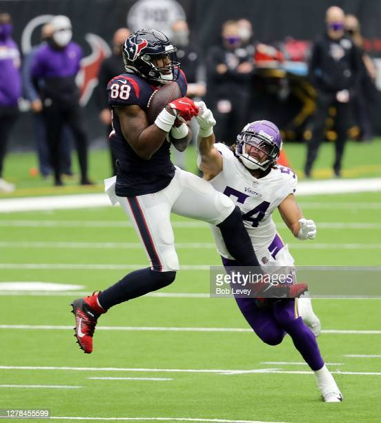 Jordan Akins of the Houston Texans makes a catch as Eric Kendricks of the Minnesota Vikings is in on the tackle during the second quarter at NRG...