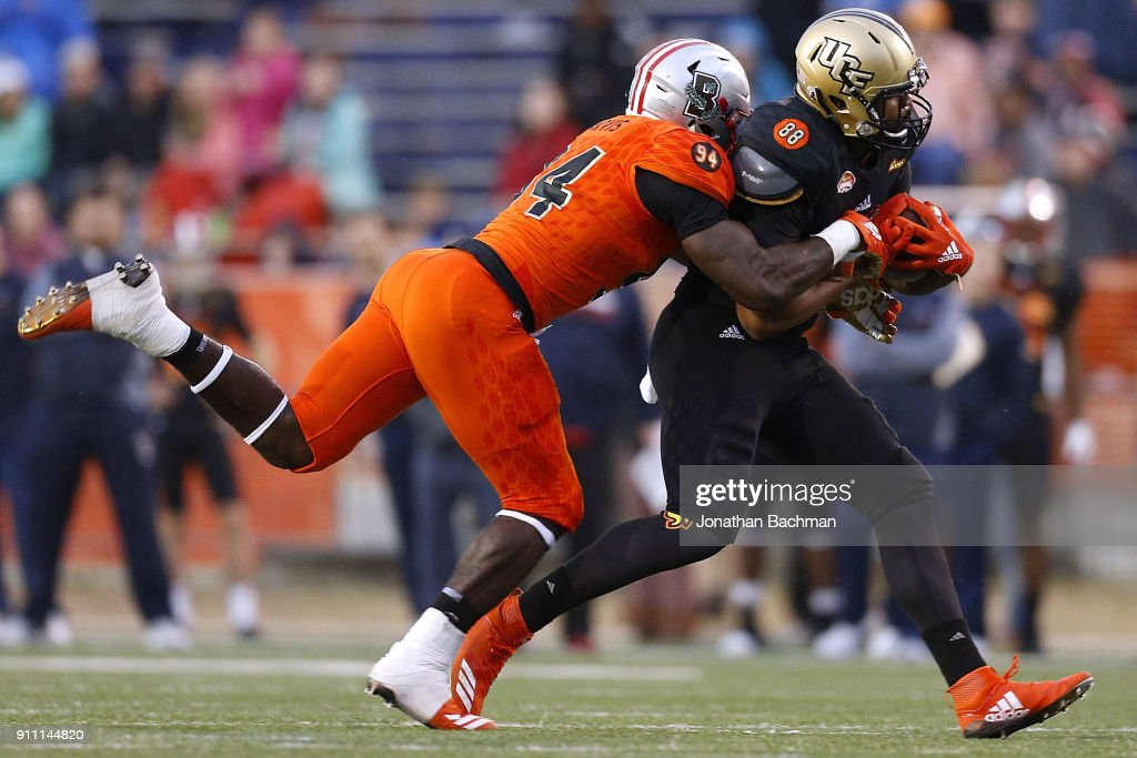 Jordan Akins #88 of the South team is tackled by Dewey Jarvis #94 of the North team during the second half of the Reese's Senior Bowl at Ladd-Peebles Stadium on January 27, 2018 in Mobile, Alabama.