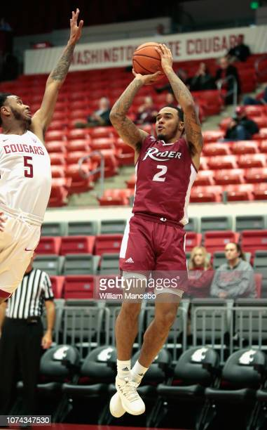 Jordan Allen of the Rider Broncs puts up a shot in the second half against Marvin Cannon of the Washington State Cougars at Beasley Coliseum on...