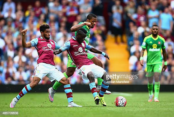 Jordan Amavi and Idrissa Gueye of Aston Villa block the way of Jeremain Lens of Sunderland during the Barclays Premier League match between Aston...