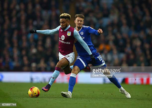 Jordan Amavi of Aston Villa and Cardiff City's Anthony Pilkington of Cardiff during the Sky Bet Championship match between Aston Villa and Cardiff...