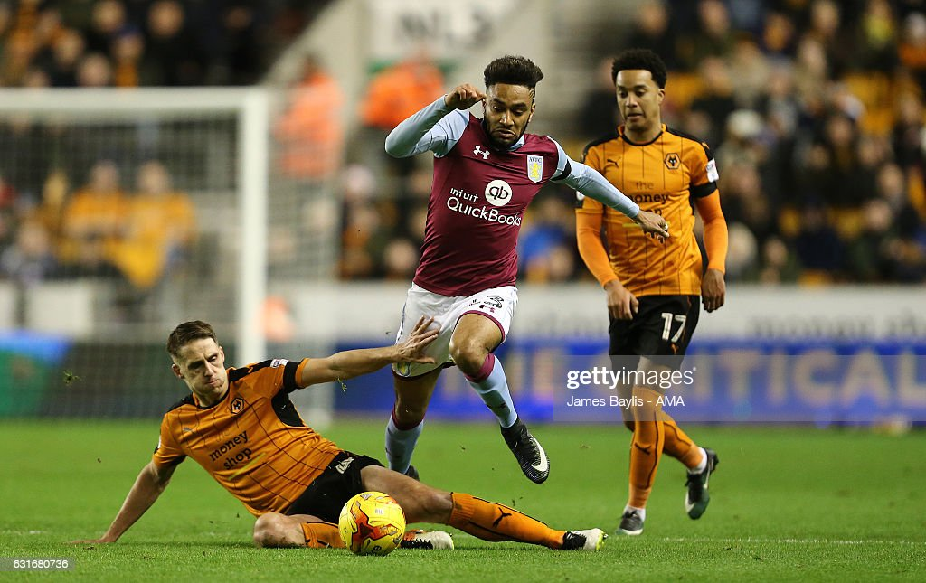 Jordan Amavi of Aston Villa and Dave Edwards of Wolverhampton Wanderers during the Sky Bet Championship match between Wolverhampton Wanderers and Aston Villa at Molineux on January 14, 2017 in Wolverhampton, England.