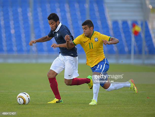 Jordan Amavi of France battles with Alisson of Brazil during the Final of the Toulon Tournament between France and Brazil at the Parc des Sports...