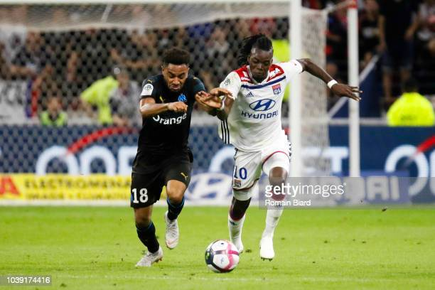Jordan Amavi of Marseille and Bertrand Traore of Lyon during the Ligue 1 match between Lyon and Marseille at Parc Olympique on September 23 2018 in...