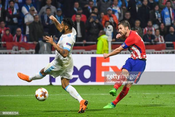 Jordan Amavi of Marseille and Gabi of Atletico Madrid scores the third goal during the Europa League Final match between Marseille and Atletico...