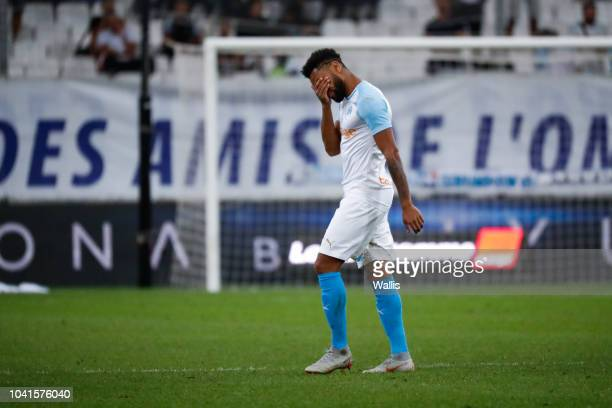 Jordan Amavi of Marseille looks dejected after receiving a red card during the Ligue 1 match between Marseille and Strasbourg at Stade Velodrome on...