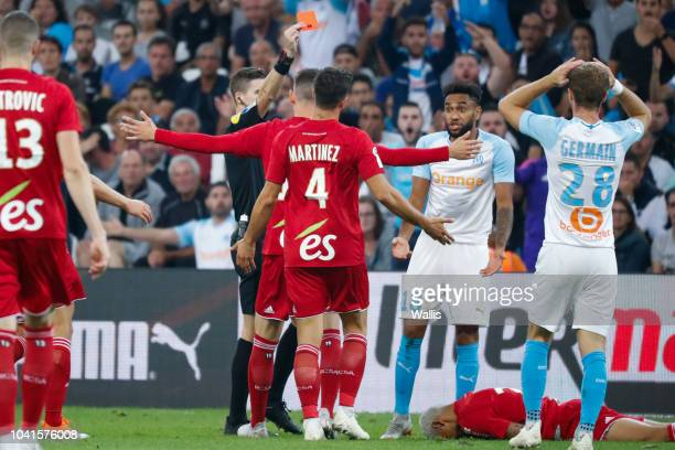 Jordan Amavi of Marseille received a red card during the Ligue 1 match between Marseille and Strasbourg at Stade Velodrome on September 26 2018 in...