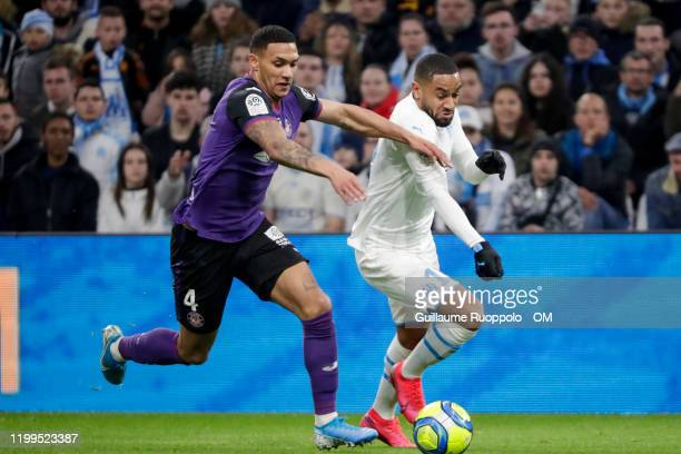 Jordan Amavi of Olympique Marseille fights for the ball with Ruben Gabrielsen of Toulouse during the Ligue 1 match between Olympique Marseille and...