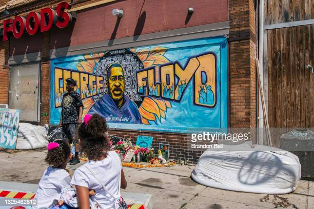 Jordan and Royal Pacheco view a memorial of George Floyd murder at the intersection of 38th Street and Chicago Avenue, ahead of former Minneapolis...