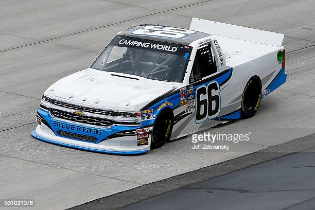 Jordan Anderson driver of the Columbia SC Famously Hot Chevrolet practices for the NASCAR Camping World Truck Series at Dover International Speedway...