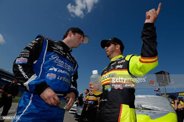 Jordan Anderson driver of the Sefton Steel/Mark Martin Podcast Chevrolet talks with Matt Crafton driver of the Matador/Menards Ford during the US...