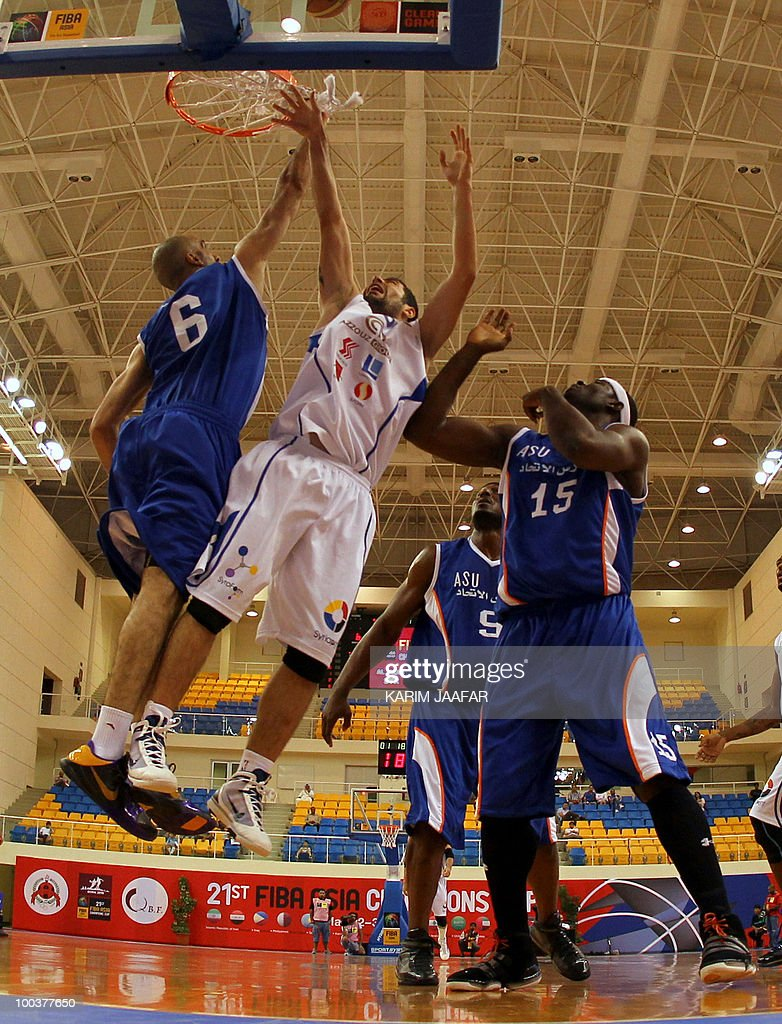Jordan ASU club US player Olumide Oyedeji (R) and Zaid Abbas (L) try to score past Syrian Al-Jalaa player Micheal Madanly (C) from scoring during their 21st FIBA Asia Champions Cup basketball match at the Al-Gharafa indoors stadium in Doha on May 24, 2010.
