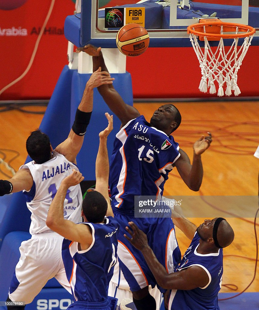 Jordan ASU club US player Olumide Oyedeji (R) fights for the ball against Syrian Al-Jalaa player Marcelle Yaqqub (L) during their 21st FIBA Asia Champions Cup basketball match at the Al-Gharafa indoors stadium in Doha on May 24, 2010.
