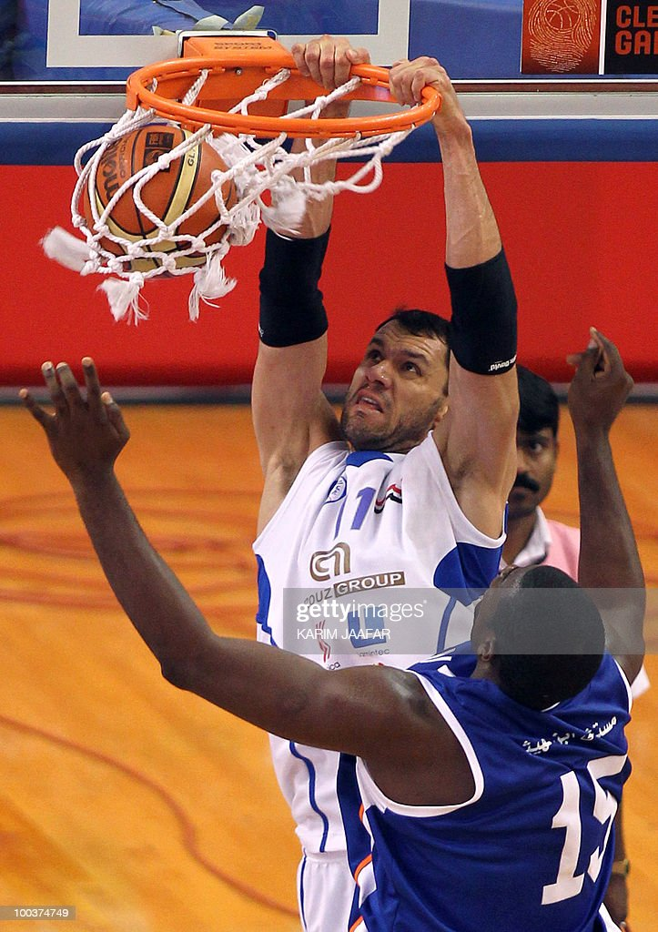 Jordan ASU club US player Olumide Oyedeji (front) tries to stop Syrian Al-Jalaa player Marcelle Yaqqub (back) from scoring during their 21st FIBA Asia Champions Cup basketball match at the Al-Gharafa indoors stadium in Doha on May 24, 2010.