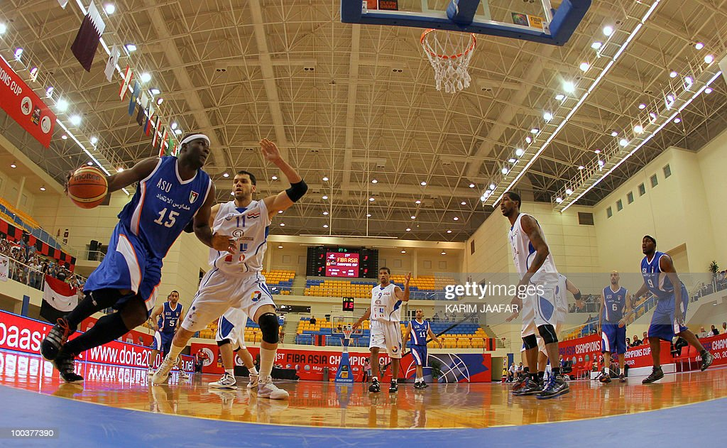 Jordan ASU club US player Olumide Oyedeji (L) vies with Syrian Al-Jalaa player Marcelle Yaqqub (2nd L) from scoring during their 21st FIBA Asia Champions Cup basketball match at the Al-Gharafa indoors stadium in Doha on May 24, 2010.