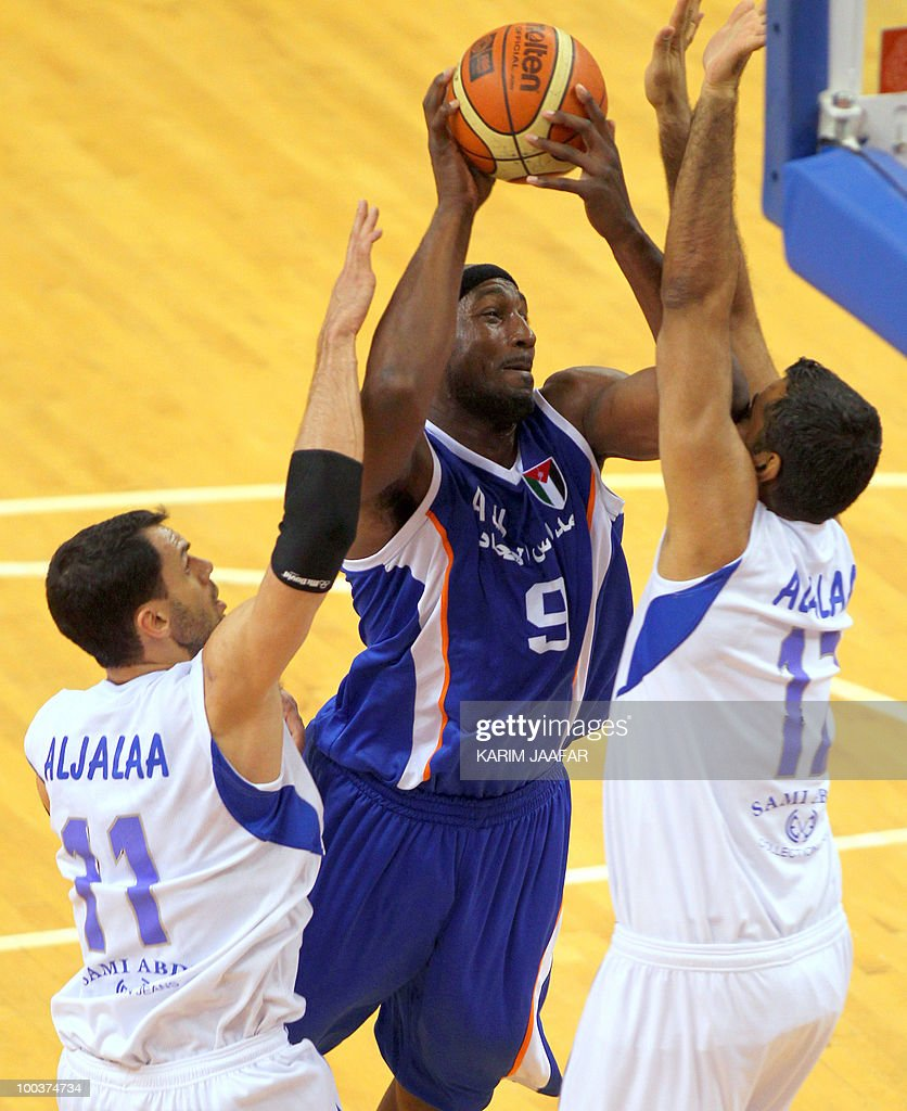 Jordan ASU club US player Williams James (C) jumps for the ball against Syrian Al-Jalaa players Marcelle Yaqqub (L) and Eder Arjo Gorges (R) during their 21st FIBA Asia Champions Cup basketball match at the Al-Gharafa indoors stadium in Doha on May 24, 2010.