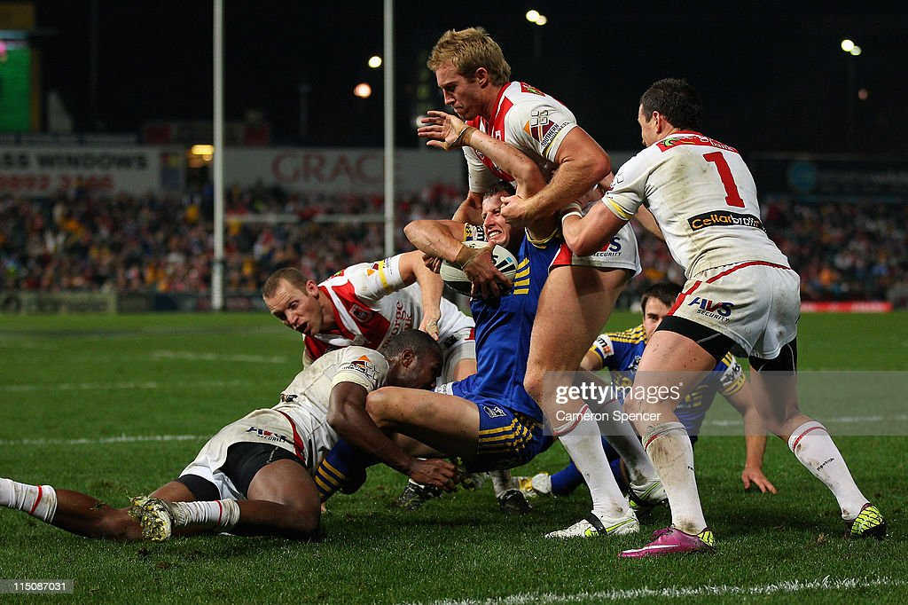Jordan Atkins of the Eels is tackled during the round 13 NRL match between the Parramatta Eels and the St George Illawarra Dragons at Parramatta Stadium on June 3, 2011 in Sydney, Australia.