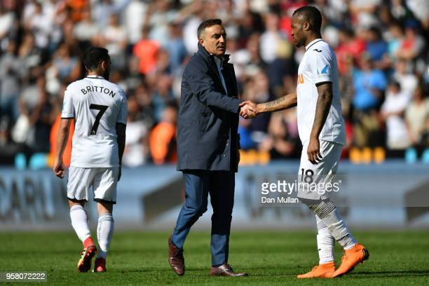 Jordan Ayew and Carlos Carvalhal Manager of Swansea City shake hands during the Premier League match between Swansea City and Stoke City at Liberty...