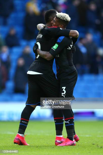Jordan Ayew celebrates with Patrick van Aanholt of Crystal Palace during the Premier League match between Brighton Hove Albion and Crystal Palace at...