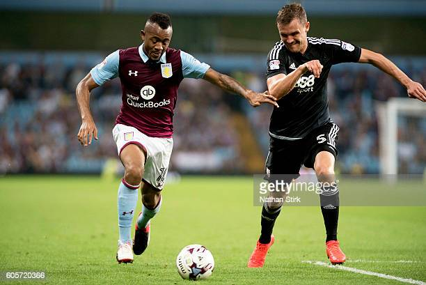Jordan Ayew of Aston Villa and Andreas Bjelland of Brentford in action during the Sky Bet Championship match between Aston Villa and Brentford at...